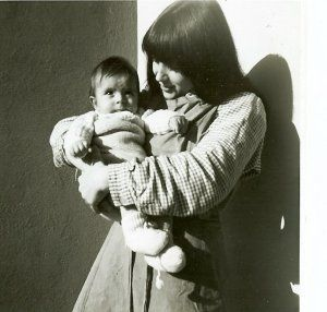 Ursula Biondi holds her infant son (both dressed in prison clothes) in this undated photo. Biondi was among thousands of Swiss teenagers and young adults who were sent to prison or labor camps without trial. After decades of silence, they are now speaking out.